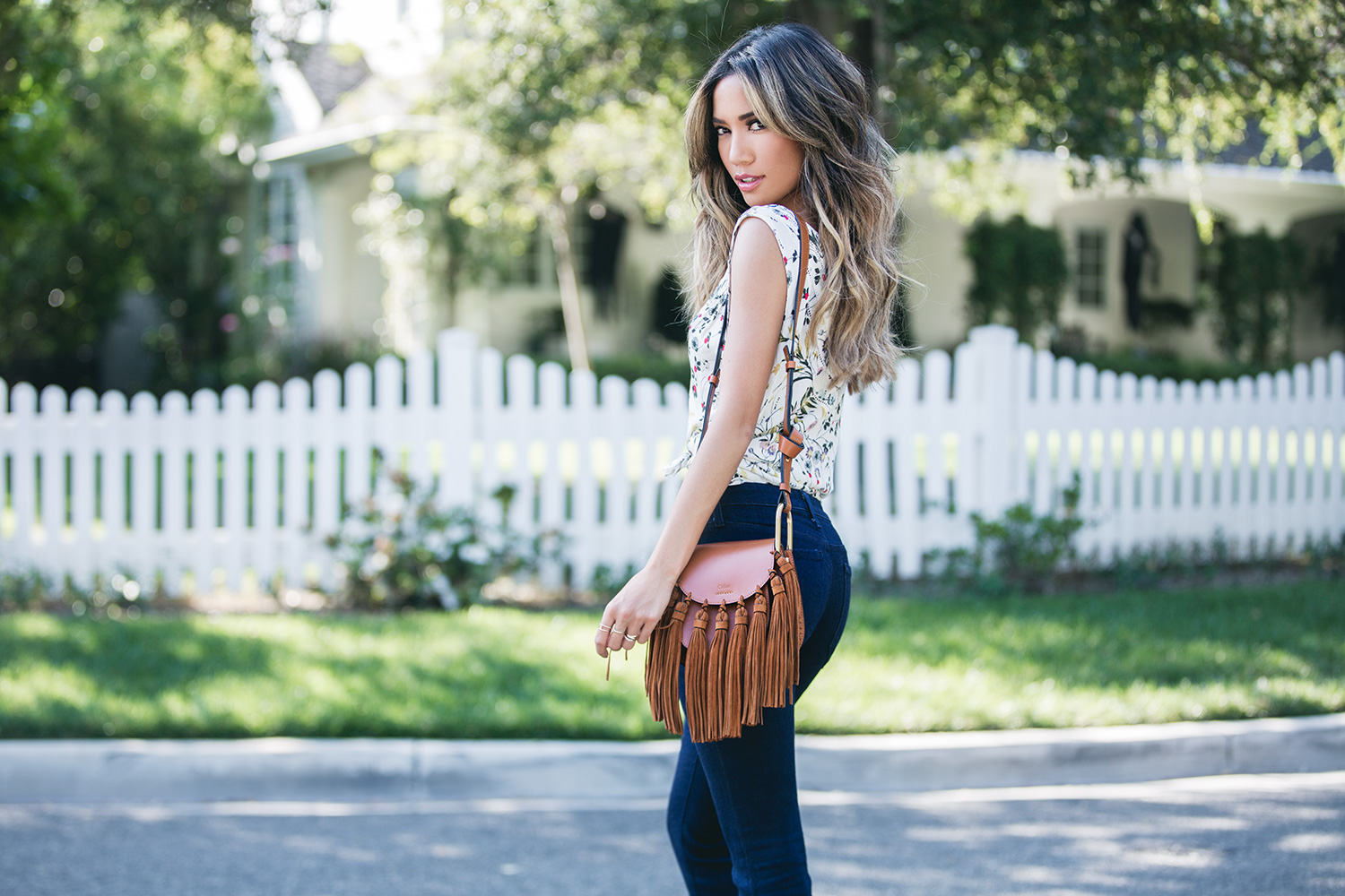 Jessi Malay wearing Chloe Hudson Mini Fringe Bag