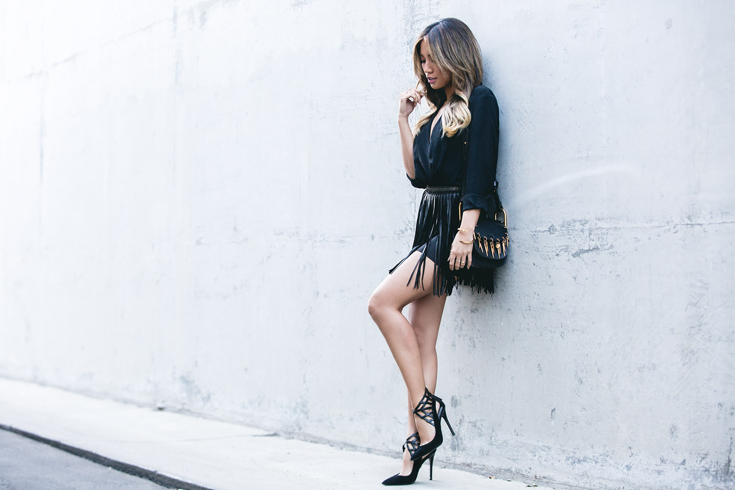Jessi Malay wearing MLV Fringe Skirt