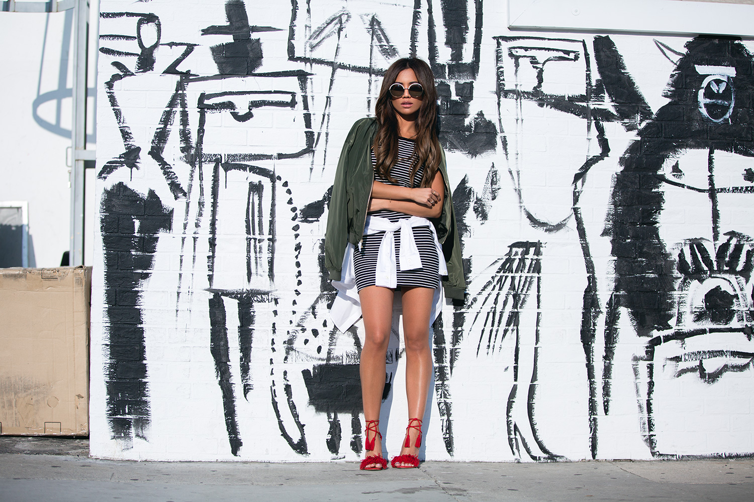 Jessi Malay wearing Express Olive Bomber Jacket