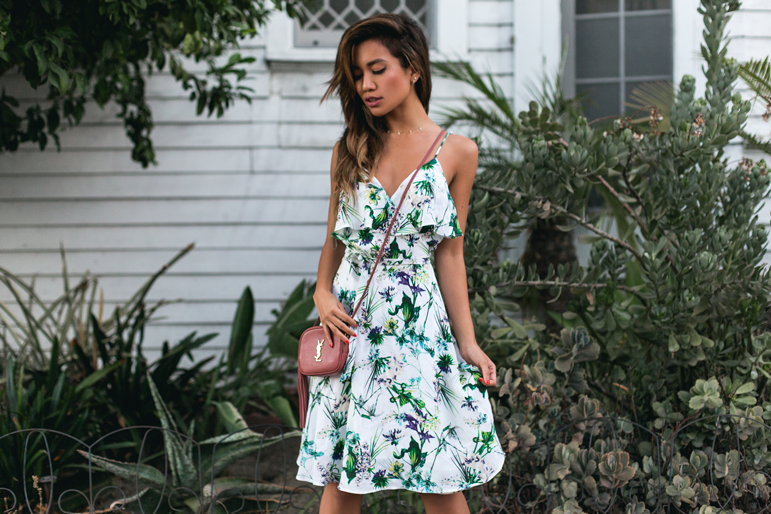 Jessi Malay wearing Amour Vert Barrett Silk Wrap Dress