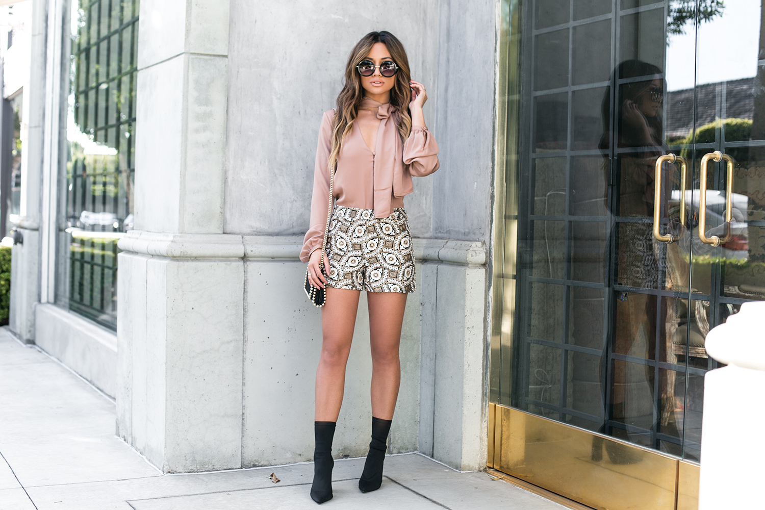 Jessi Malay wearing Alice and Olivia Shorts and L'Acadamie top