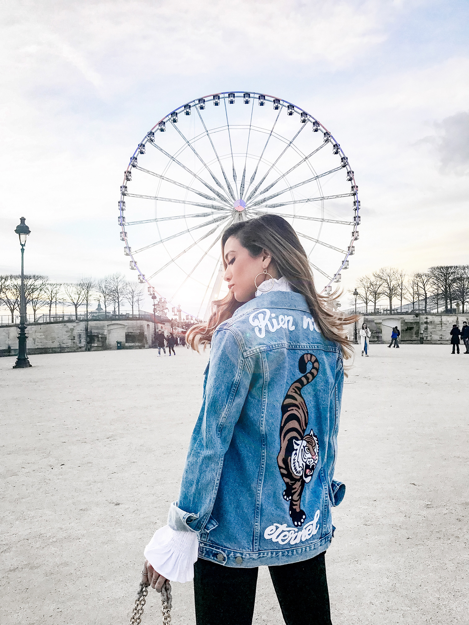 Jessi Malay wearing GRLFRND Denim Jacket
