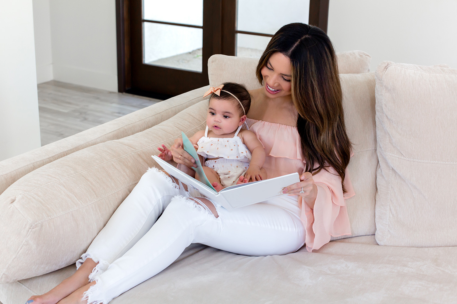 Jessi Malay and Baby Alessandra reading