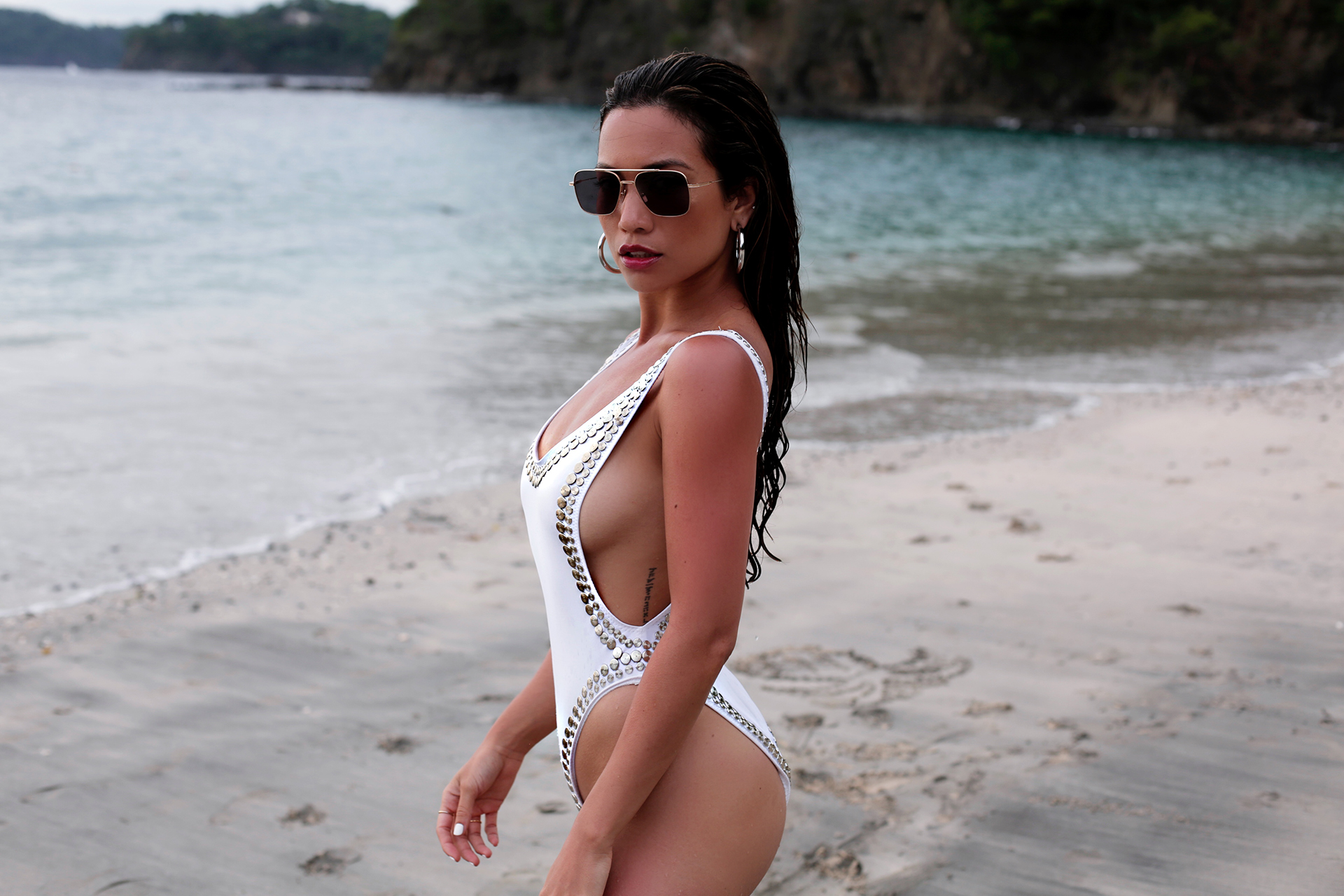 Jessi Malay wearing Norma Kamali one piece swimsuit