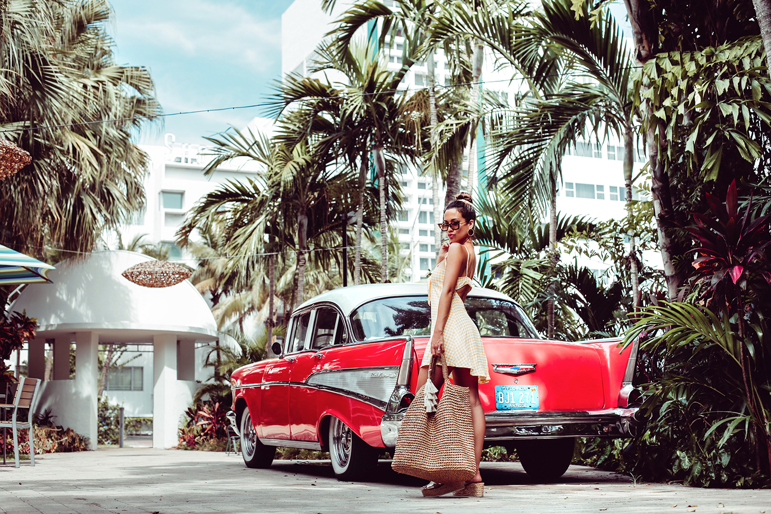 Jessi Malay Miami wearing straw tote