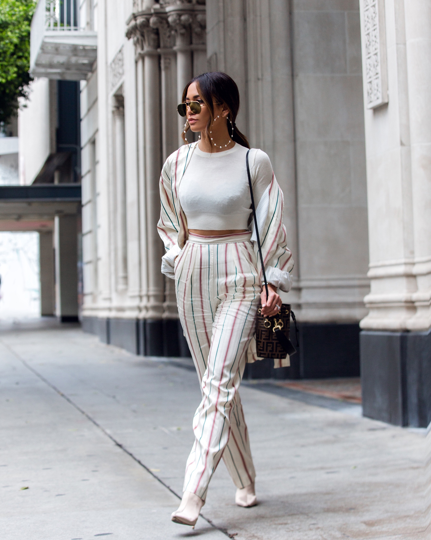 Jessi Malay wearing pinstripe suit trend
