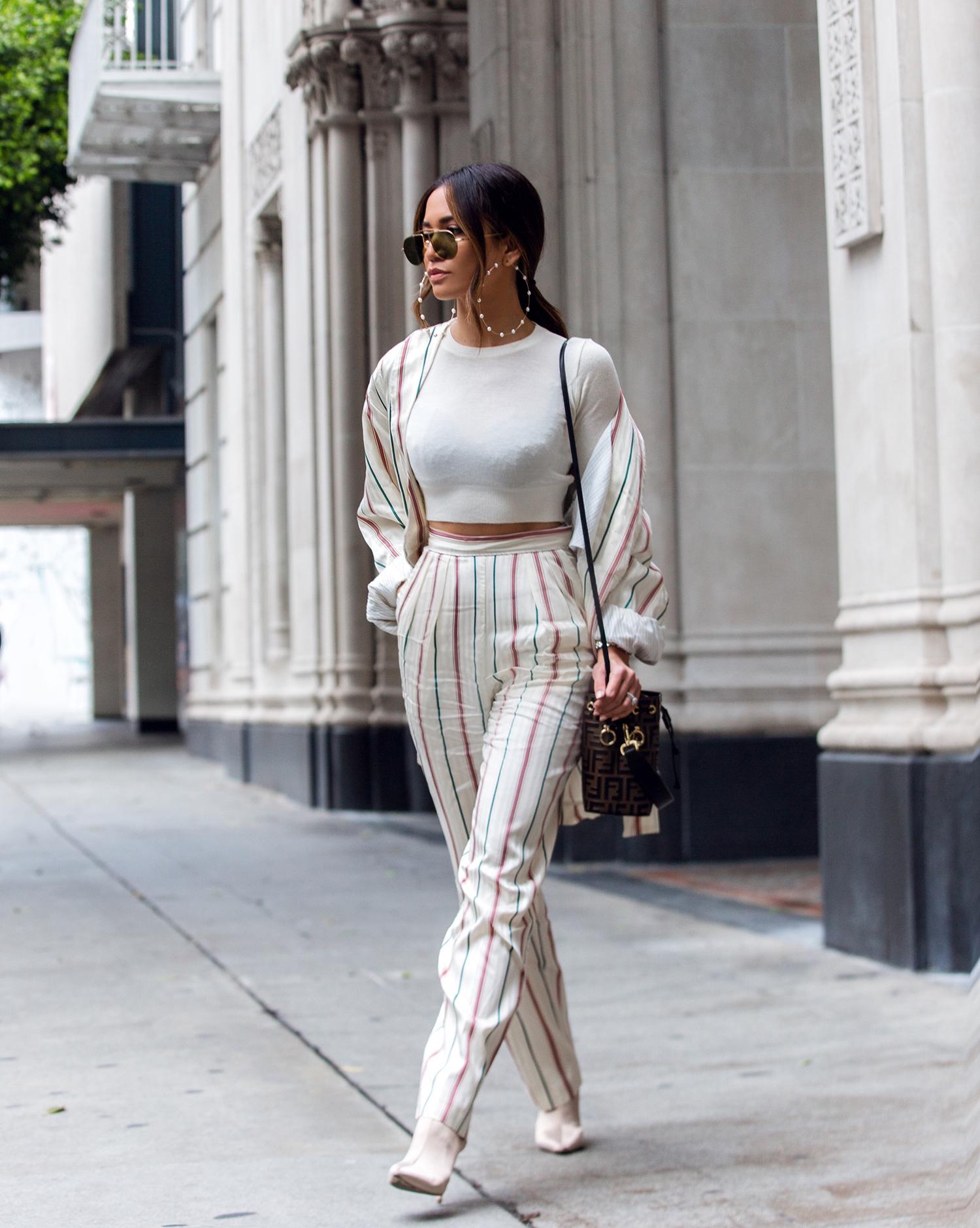 Jessi Malay wearing pinstripe suit trend